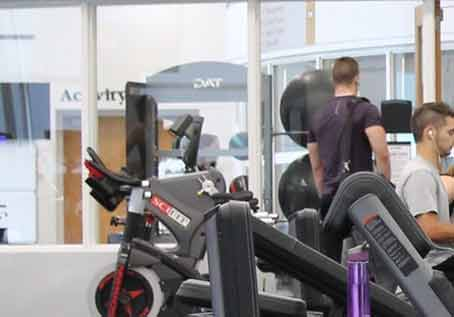 student athletes training in a college fitness center