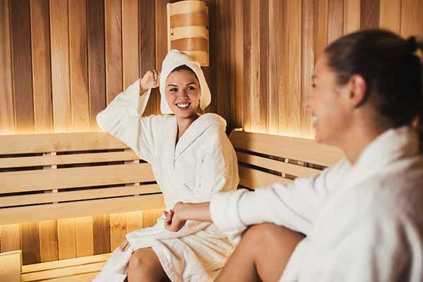 women enjoying a relaxing sauna