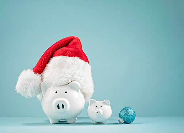 piggy bank with santa hat for holiday gym discounts