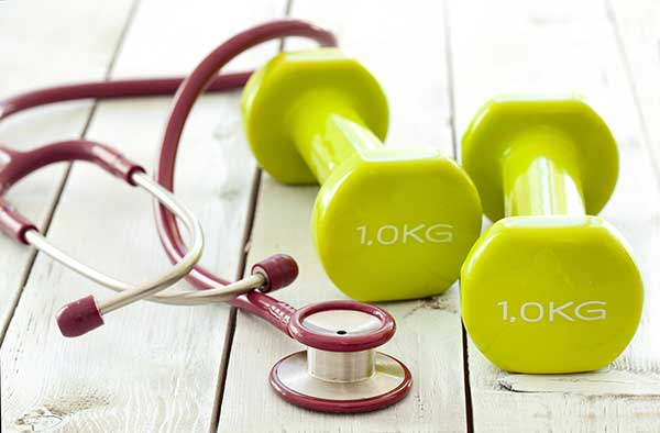 stethescope and weights for working out