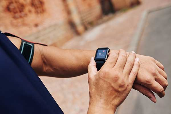 man checking his pulse on a smart watch